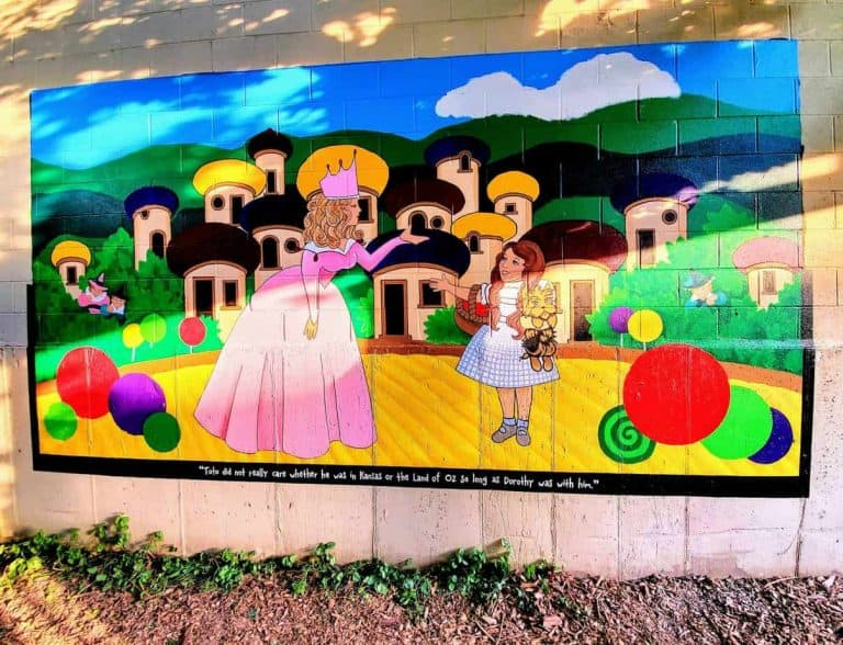 Mural of Glenda, Dorothy and Toto on the Yellow Brick Rd.