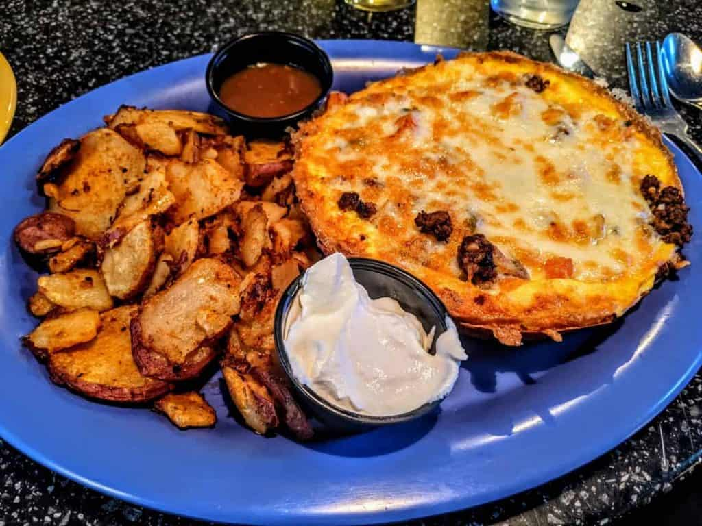 My favorite breakfast in town! This Frittata has three eggs mixed with Chorizo sausage, pico De Gallo and jack cheese. Top with Chipotle sauce and add homestyle potatoes to make the perfect breakfast!